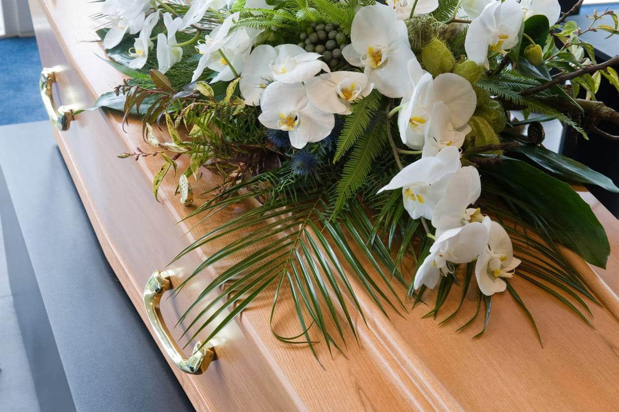 fleurs plaque hommage enterrement funérailles